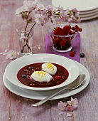 Jellied berry soup with poached meringues
