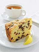 A piece of fruit cake with lemon tea