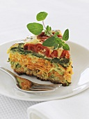 A piece of vegetable pie (with tomatoes, courgettes & spinach)