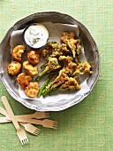 Pakoras (Deep-fried vegetables in batter with dip, India)