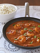 Prawns in tomato sauce and rice with cumin seeds