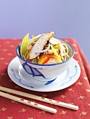 Asian noodle stir-fry with chicken and mango