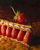 Brik pastry with caramel filling and strawberries