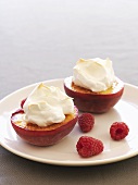 Grilled peaches with meringue topping and raspberries