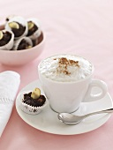 A cup of cappuccino and home-made chocolates