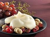 Zabaglione with grapes and amaretti (close-up)