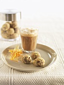 Chocolate truffles and a glass of milky coffee