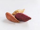 Three sweet potatoes of different varieties
