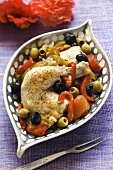 Braised chicken leg with peppers and olives