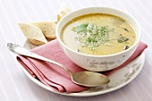 Creamy mushroom soup with dill and pancake rolls