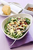 Spinach salad with dried tomatoes and cheese