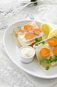 Fish and carrots in aspic with creamed horseradish