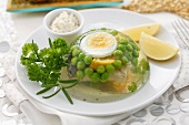 Carp with egg and peas in aspic