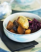 Vegetable stew (pumpkin, red cabbage) with dumplings for Xmas
