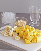 Pineapple chunks, banana slices and flaked almonds