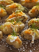 Potatoes baked in salt with sour cream and caviar