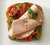 Ham, grilled tomato and red pepper on bread