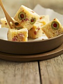 Cubes of olive cake (tapas)