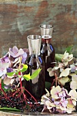Elderberry syrup, elderberries and hydrangeas