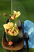 Exotic fruit salad in a banana leaf
