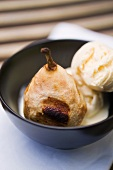 Baked pear with vanilla ice cream