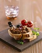 Tomato and olive paste on farmhouse bread