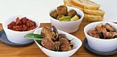 Tandoori turkey, lamb rolls, bacon-wrapped plums, meatballs