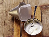 Natural yoghurt and conical sieve with filter paper