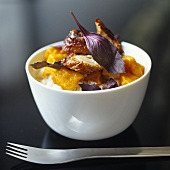 Roast duck breast with pumpkin and purple basil on rice