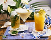 Mojito, mango and coconut cocktail and pineapple drink