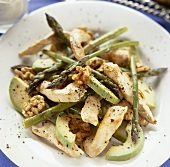 Avocado, chicken and green asparagus salad with walnuts