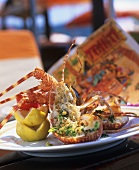 Spiny lobster, split and grilled, with herbs