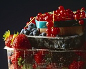 Fresh berries in plastic containers and punnet