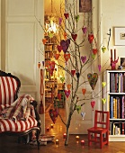 Branch decorated with felt hearts in a living room