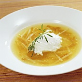 Sherry consommé with julienne vegetables and poached egg