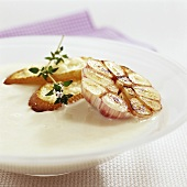Cream of garlic soup with toasted baguette slices