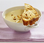 Cold almond cream soup with toasted bread