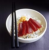 Tuna sashimi on rice with sesame seeds