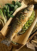Bass with herbs and lime slices (Vietnam)