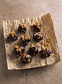 Chocolate plum sweets with almond brittle