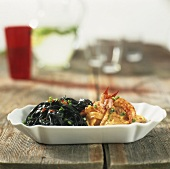 Black pasta with crayfish sauce