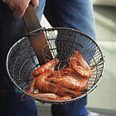 Prawns in deep-frying basket