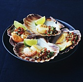 Fried scallops with chilli salsa and lime wedges