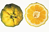 Ugli fruit, whole and halved