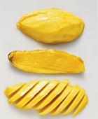 Peeled mango and mango stone