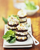 Cheese spread sandwiches with pine nuts made with pumpernickel