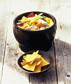 Chicken, vegetable and rice stew with nachos