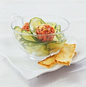 Salmon balls with cucumber salad and fingers of toast