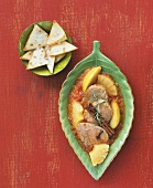 Pork cheeks with tomato sauce, pineapple and apple