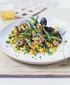 Pan-cooked saffron rice with clams, asparagus and pork